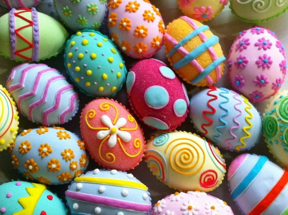 Blow out the interiors of each egg before decorating, then hand-paint with various shades of acrylic paint. Once dry, use a liner brush to paint polka dots, swirls or other designs with glue onto painted eggs.